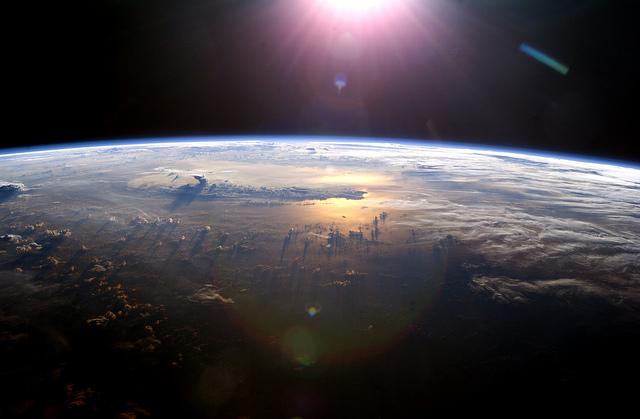 Sun Over Earth (NASA, International Space Station, 07/21/03)